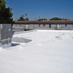 Commercial foam roof with vents near apartments