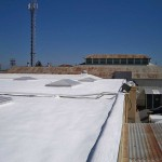 Dura-Foam commercial roofing with skylights visible