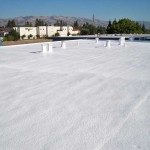 Spray foam on flat building roof
