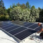 Solar panels getting installed by technician
