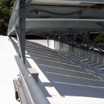 Commercial solar roof. View under solar panels