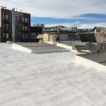 Commercial dura foam roof next to neighboring buildings