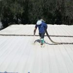 Foam spray roofing application by Dura-Foam worker