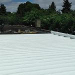 Dura-Foam roof in progress. Foam over metal.