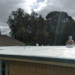 Residential dura foam roof with cloudy sky