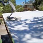 Polyurethane roof with satellite dish