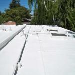 Sprayed foam roofing. HVAC visible under foam.