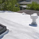 Spray foam roofing including vents and skylights