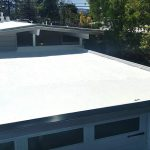 Spray Polyurethane Foam roof on grey Eichler house.