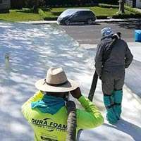 Dura-Foam employees installing foam roof