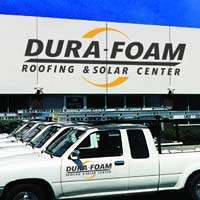 Dura-Foam shot in front of company building with company trucks